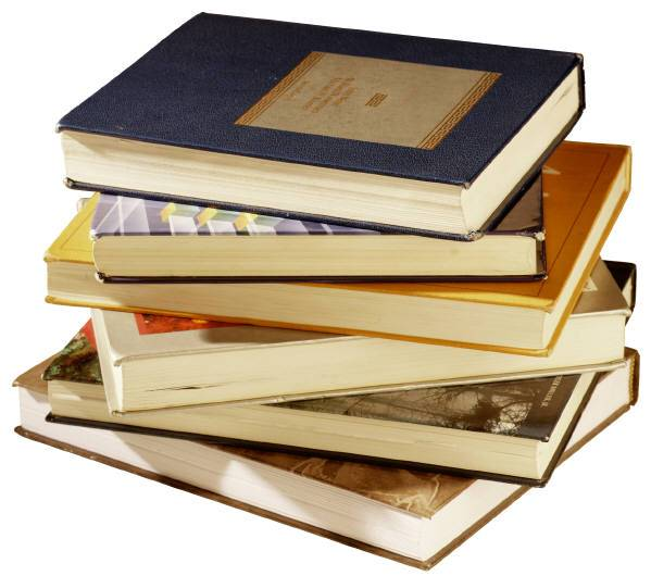 pile of books - IndieReader